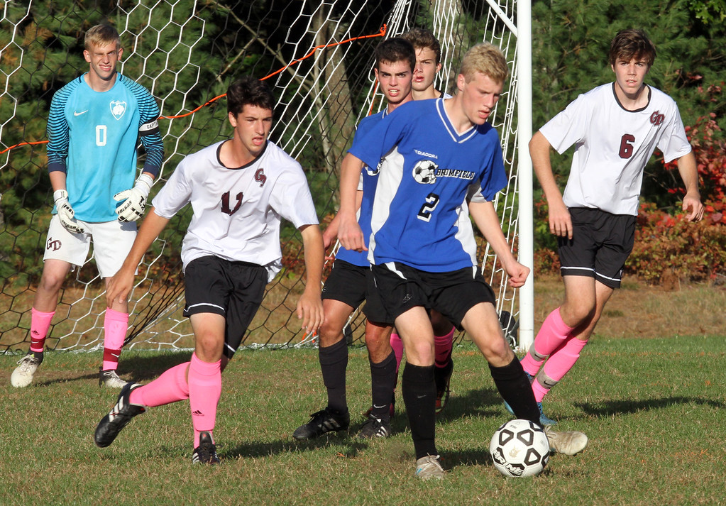 . Groton-Dunstable vs Bromfield Academy boys soccer. Groton-Dunstable goalie Mitchel Hardy, left, Aidan Ferreira (13) and Samuel Enke (6), and Bromfield\'s Ryell Derjviter (2). (SUN/Julia Malakie)