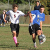 Groton-Dunstable vs Bromfield Academy boys soccer. Groton-Dunstable's Justin Meyer (5) and Bromfield's Marcos Lora (21). (SUN/Julia Malakie)