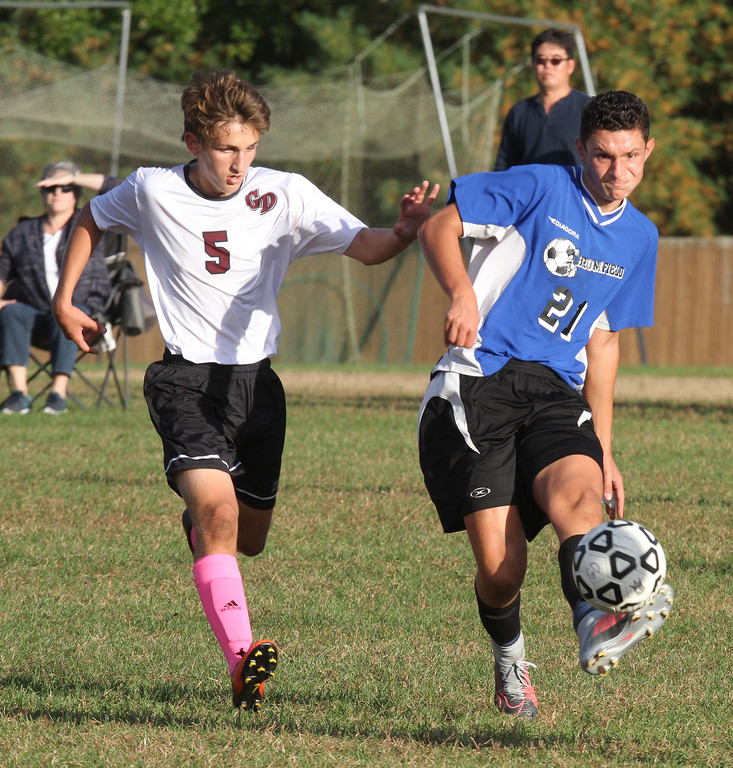 . Groton-Dunstable vs Bromfield Academy boys soccer. Groton-Dunstable\'s Justin Meyer (5) and Bromfield\'s Marcos Lora (21). (SUN/Julia Malakie)