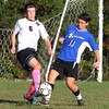 Groton-Dunstable vs Bromfield Academy boys soccer. Groton-Dunstable's Samuel Enke (6) and Bromfield's Shane Bilodeau (11). (SUN/Julia Malakie)