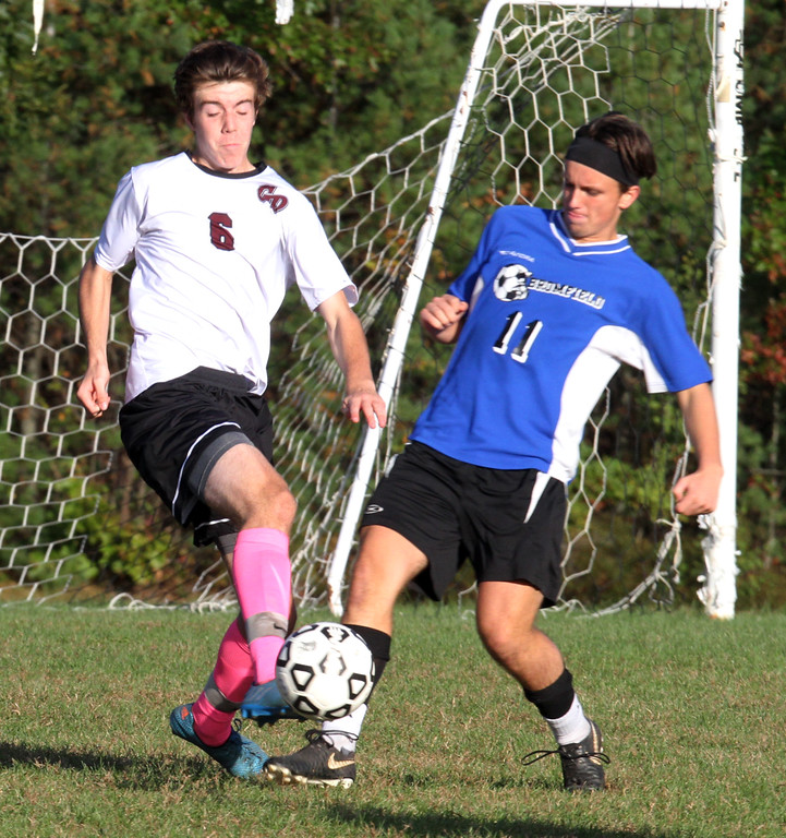 . Groton-Dunstable vs Bromfield Academy boys soccer. Groton-Dunstable\'s Samuel Enke (6) and Bromfield\'s Shane Bilodeau (11). (SUN/Julia Malakie)