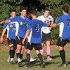 Groton-Dunstable vs Bromfield Academy boys soccer. Bromfield players celebrate goal by Shane Bilodeau (11), off Reilly Fitimmons (4), that gave Bromfield a 3-0 lead. Charlie Pappas (10) and Jack Armstrong (7). (SUN/Julia Malakie)