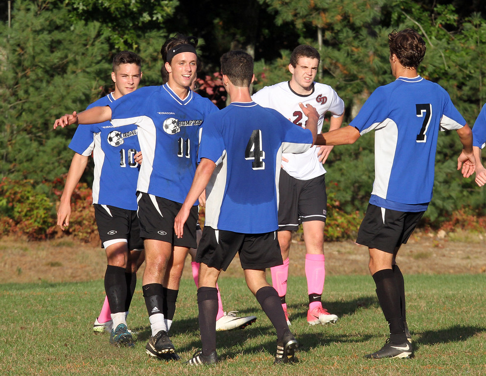 . Groton-Dunstable vs Bromfield Academy boys soccer. Bromfield players celebrate goal by Shane Bilodeau (11), off Reilly Fitimmons (4), that gave Bromfield a 3-0 lead. Charlie Pappas (10) and Jack Armstrong (7). (SUN/Julia Malakie)