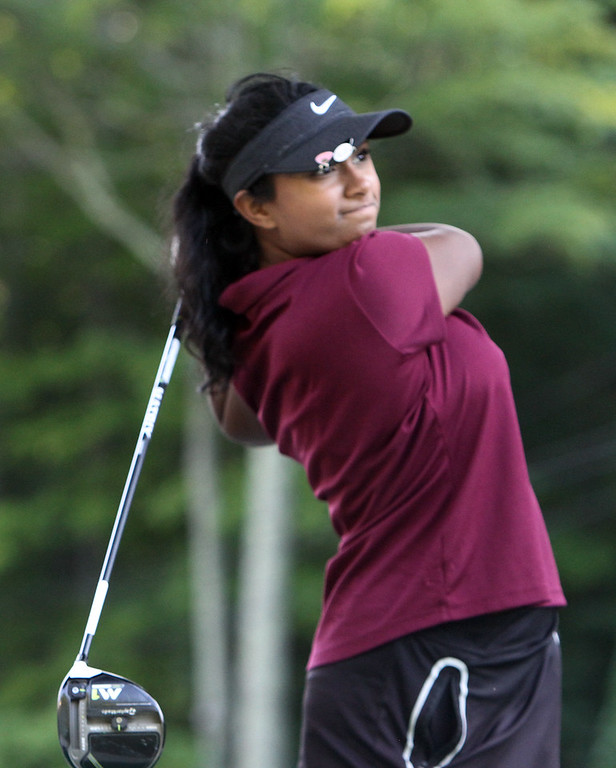. Groton-Dunstable golfer Isabelle Premkumar, 17, a senior, finishing round at Groton Country Club. (SUN/Julia Malakie)