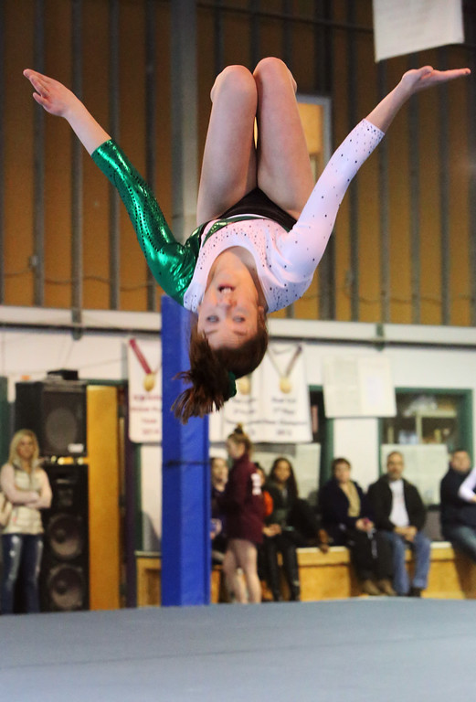 . Chelmsford, Dracut, Billerica and Lowell in gymnastics meet. Erin Huckins of Billerica in floor exercise. (SUN/Julia Malakie)