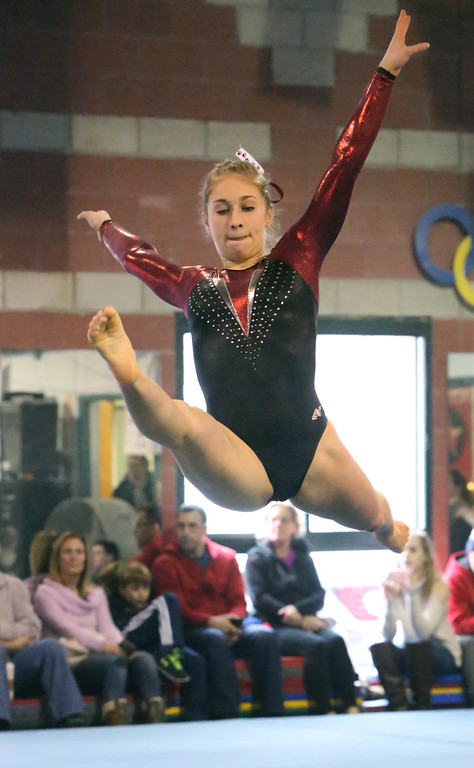 . Chelmsford, Dracut, Billerica and Lowell in gymnastics meet. Sara Bourdelais of Chelmsford on floor exercise. (SUN/Julia Malakie)
