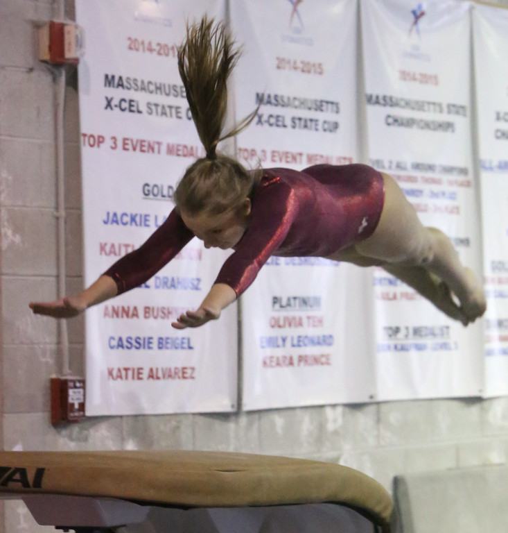 . Chelmsford, Dracut, Billerica and Lowell in gymnastics meet. Jillian Reid of Lowell on vault. (SUN/Julia Malakie)