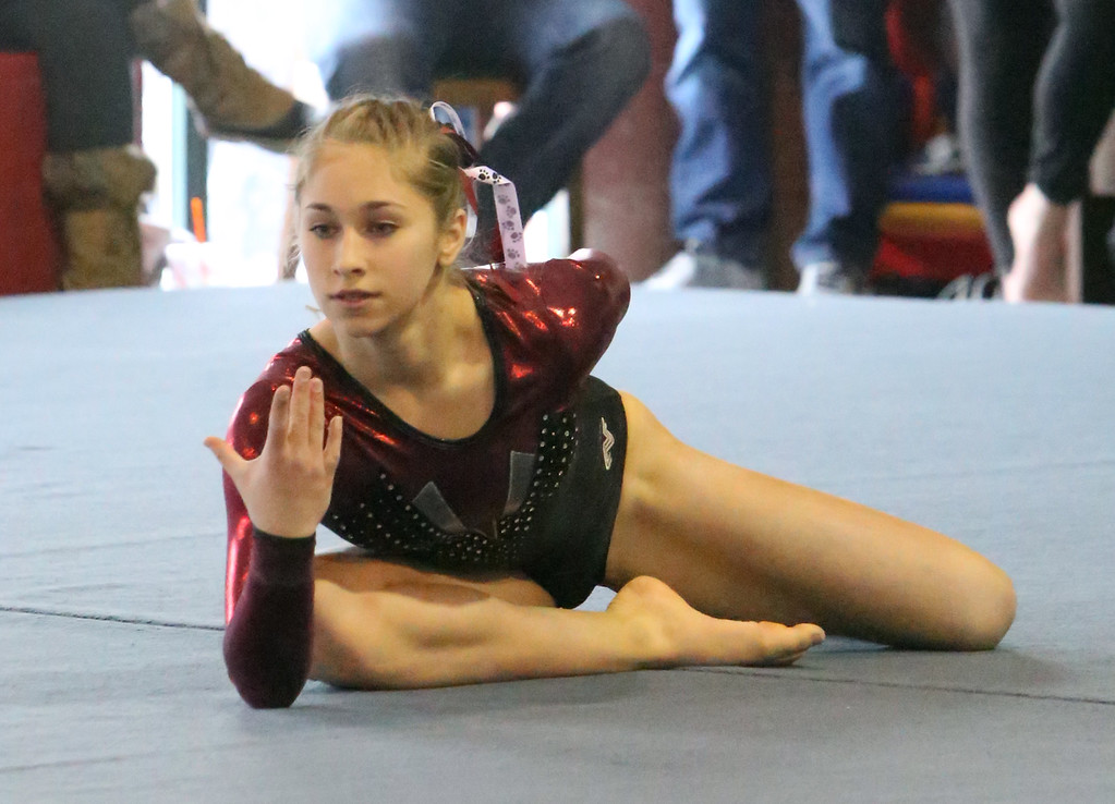 . Chelmsford, Dracut, Billerica and Lowell in gymnastics meet. Sara Bourdelais of Chelmsford finishes her floor exercise. (SUN/Julia Malakie)