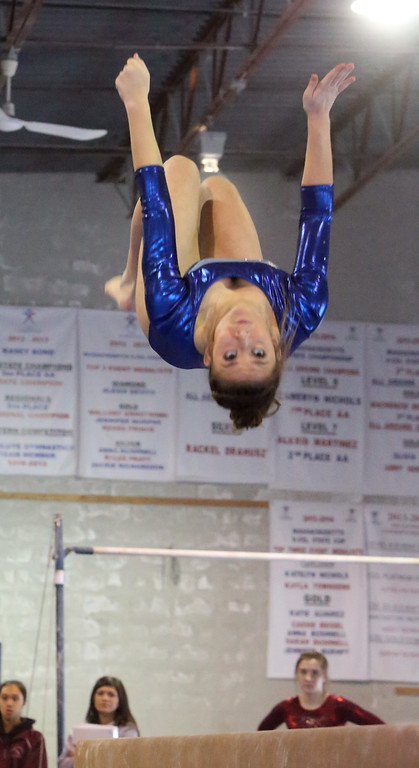 . Chelmsford, Dracut, Billerica and Lowell in gymnastics meet. Bryce McDonald of Dracut on beam. (SUN/Julia Malakie)