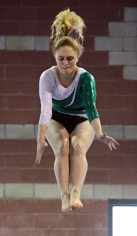 . Chelmsford, Dracut, Billerica and Lowell in gymnastics meet. Molly Jones of Billerica on balance beam. (SUN/Julia Malakie)