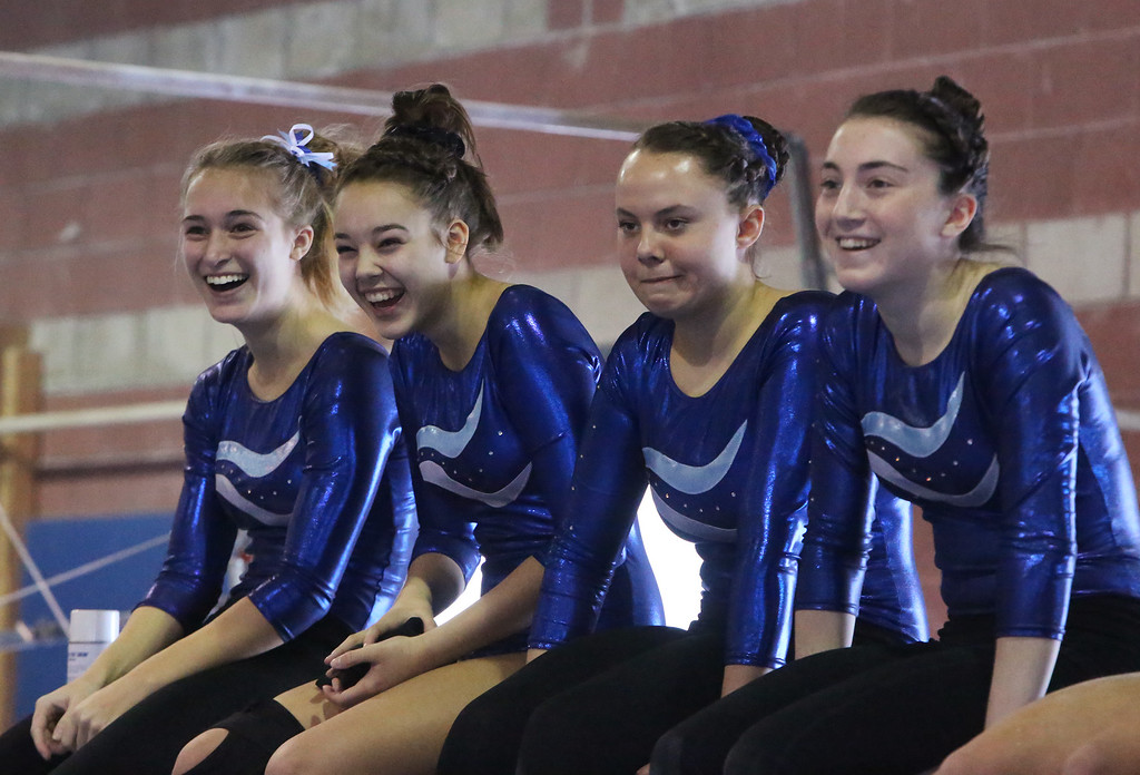 . Chelmsford, Dracut, Billerica and Lowell in gymnastics meet. From left, Sarah Wilson, Mikayla Ganley, Alyssa Quirk and Kate Cournoyer of Dracut watch a teammage on the balance beam. (SUN/Julia Malakie)