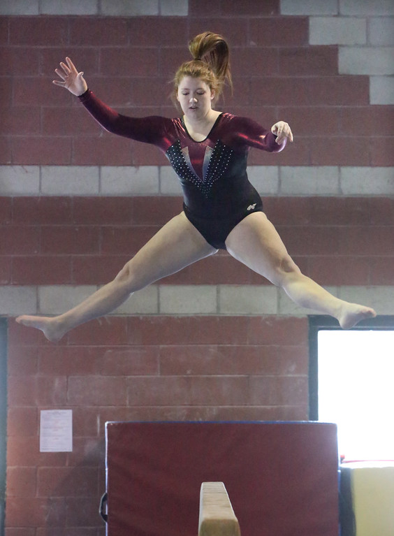 . Chelmsford, Dracut, Billerica and Lowell in gymnastics meet. Kyleigh Dimitrov of Chelmsford on balance beam. (SUN/Julia Malakie)