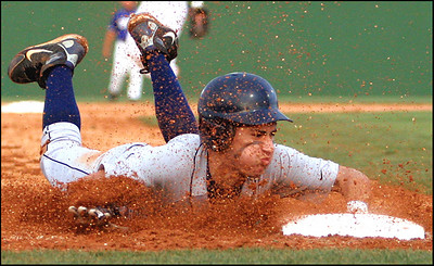 Cody Abraham of Lamar slides safely into third base during Class 4A Region III baseball playoff action Saturday.  The Mustangs could not overcome defensive woes as Barbers Hill capitalized on errors to take a 6-2 win and a series sweep.
