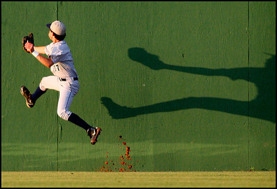 Lamar freshman Cody Abraham scales the center field wall to take an extra base hit away from Derek Hulsey of Barbers Hill.  It was not enough for the Mustangs, as Barbers Hill claimed a 6-2 win and a series sweep in Class 4A Region III baseball playoff action May 13, 2007.