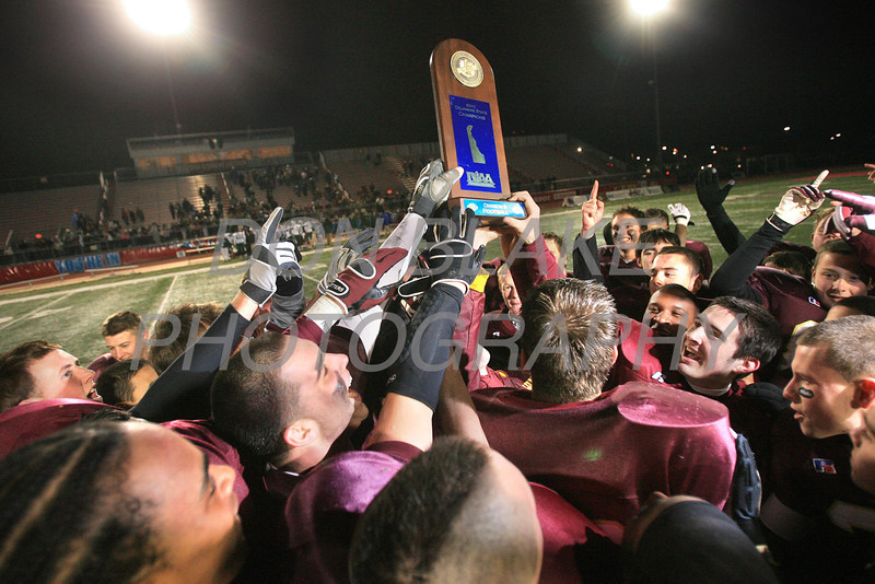 St. Elizabeth's holds up the championship trophy after their 35-0 win against Archmere in the Division 2 State Football Championship at Delaware State University in Dover, Saturday, December 4, 2010. The Dialog/Don Blake