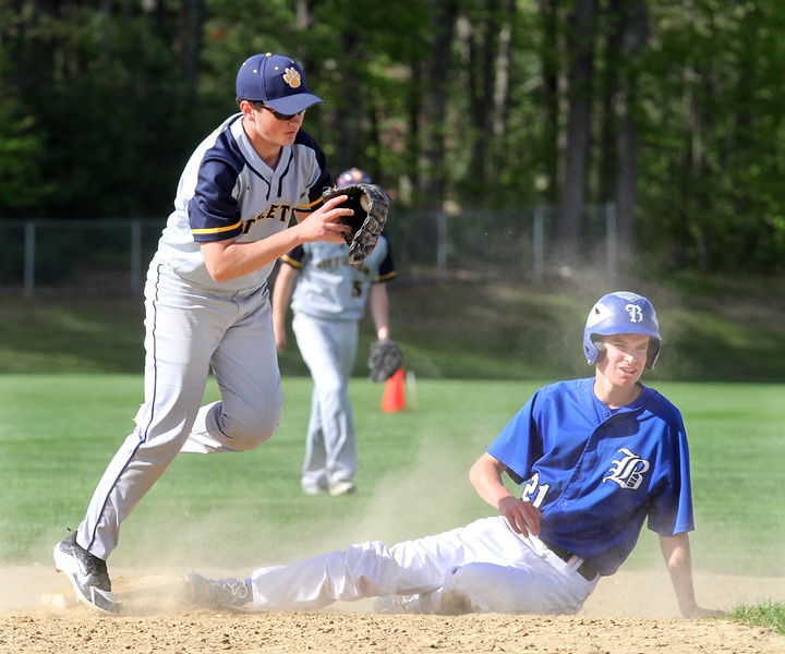 Littleton vs Bromfield baseball. Bromfield's Rory VanDorpe (21) is out trying to steal second, Littleton second baseman Matt Donlon (16) making the play to end the top of the fifth inning. (SUN/Julia Malakie)