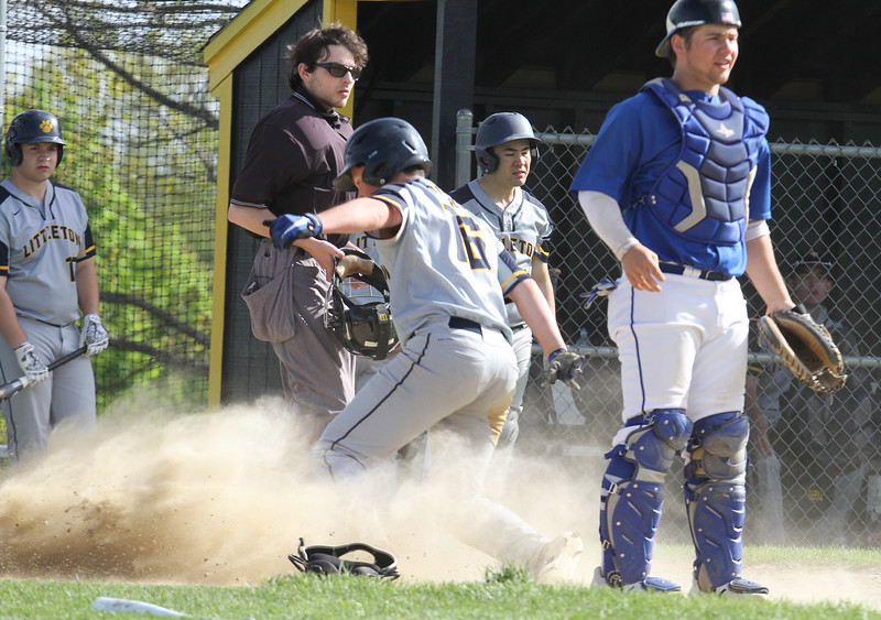 Littleton vs Bromfield baseball. Littleton's Matt Donlon is save at home on a sacrifice bunt by Evan Lyons as Bromfield catcher Alex Megan watches the pay at first in the bottom of the fifth inning. (SUN/Julia Malakie)