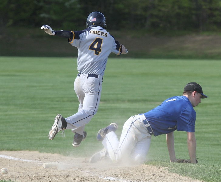 Littleton vs Bromfield baseball. Littleton's Nick Pelrine is safe at first with an infield single as Bromfield first baseman  #7 [not on roster they wrote out] loses the ball. (SUN/Julia Malakie)