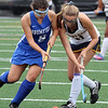 Littleton vs Bromfield field hockey. Bromfield's Jordan Hoover (9) and Littleton's Emily Bell (11). (SUN/Julia Malakie)