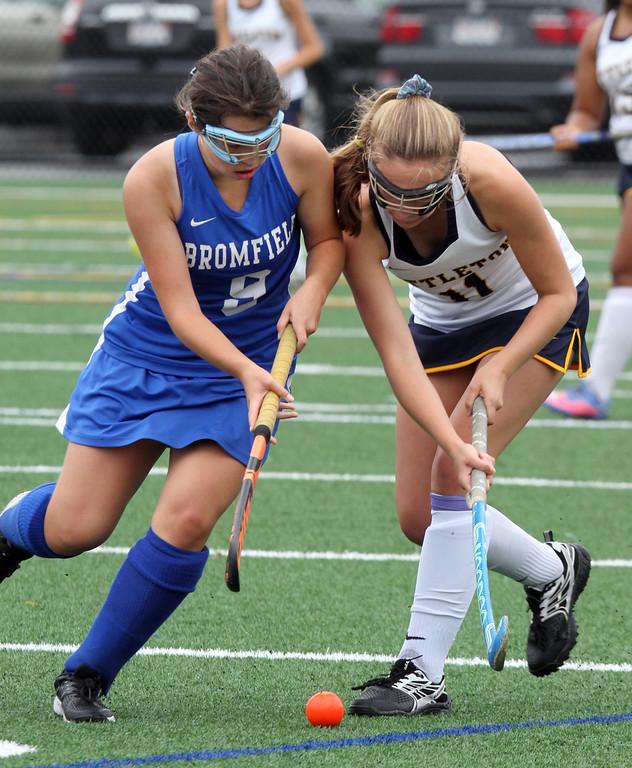 . Littleton vs Bromfield field hockey. Bromfield\'s Jordan Hoover (9) and Littleton\'s Emily Bell (11). (SUN/Julia Malakie)
