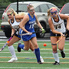 Littleton vs Bromfield field hockey. Bromfield's Ella Corbett (19) and Littleton's Amanda Yurkoski (3) and Valerie Crory (14). (SUN/Julia Malakie)