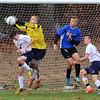 Littleton goalkeeper Dave Tornell deflects a shot. Others from left: Littleton's Matt Vacca (4), Bromfield's Mark Schiegerhausen (10) and Littleton's Devin Finnerty (6). (SUN/JULIA MALAKIE)