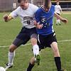 Littleton's Hayden Gray (8) and Bromfield's Nate Greene (13). (SUN/JULIA MALAKIE)