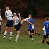 From left, Littleton's Jack Hambelton (21), Jon O'Meara (25) and Hunter Gray (11), deflect a penalty kick by Bromfield's Adam Lorenz Krun (11). [not sure of spelling; hard to read[ (SUN/JULIA MALAKIE)
