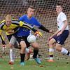 Littleton goalkeeper Dave Tornell deflects a shot. Bromfield's Mark Schiegerhausen (10) and Littleton's Devin Finnerty (6). (SUN/JULIA MALAKIE)