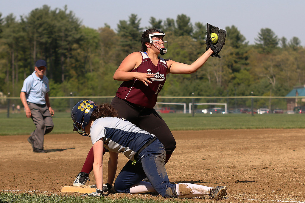 . Littleton High School softball played Ayer Shirley Regional High School on Wednesday, May 17, 2017. ASHS third baseman Hannah Justice gets the throw as LHS\'s Emily Barbella dives back to third base during action in the game. SUN/JOHN LOVE