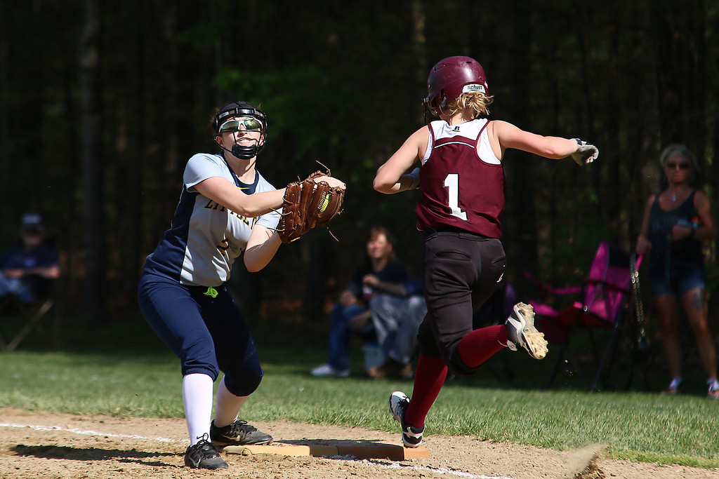 . Littleton High School softball played Ayer Shirley Regional High School on Wednesday, May 17, 2017. LHS first baseman Emily Barbella get the throw just in time to get ASHS player Shannon Mountford out during action in the game. SUN/JOHN LOVE