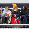 Littleton girls lacrosse spectators, from left, Dara Furlong, Tracey Johnson, CC Carroll, 13, her mom Lisa Carroll, Carla Archer and Kim McLead, try to stay warm at Alumni Stadium on a cold day for the lacrosse game vs North Middlesex. (SUN/Julia Malakie)