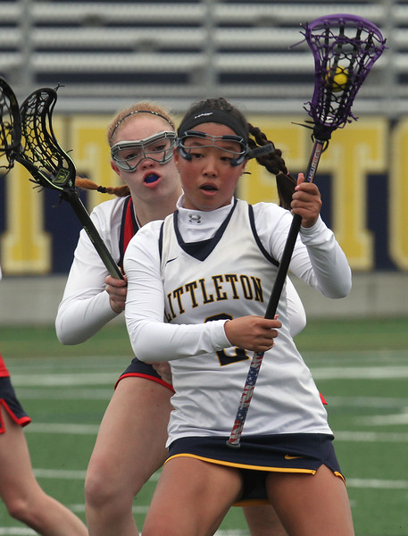 Littleton vs North Middlesex girls lacrosse. North Middlesex's Maura Hebert (17), and Littleton's Veda Hurley (2). (SUN/Julia Malakie)