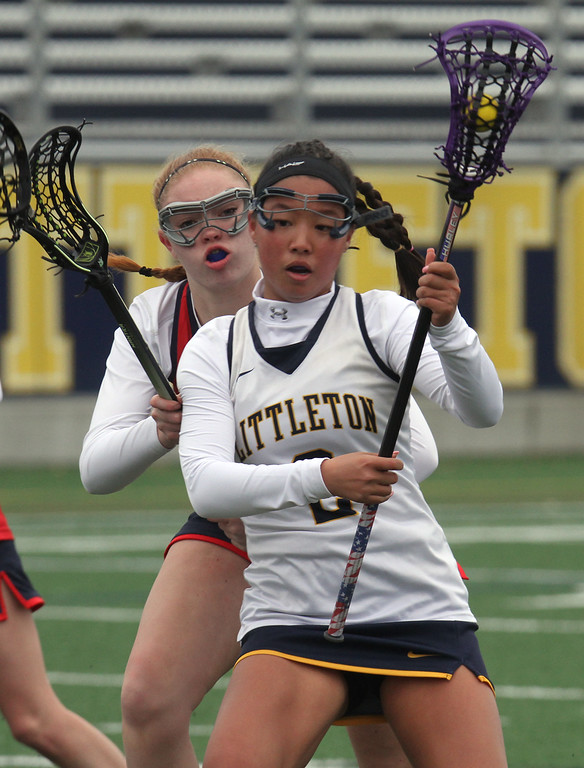 . Littleton vs North Middlesex girls lacrosse. North Middlesex\'s Maura Hebert (17), and Littleton\'s Veda Hurley (2). (SUN/Julia Malakie)