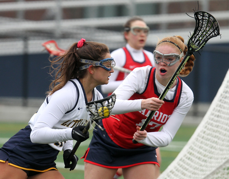 Littleton vs North Middlesex girls lacrosse. Littleton's Lauren Faber (10) and North Middlesex's Maura Hebert (17). (SUN/Julia Malakie)