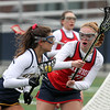 Littleton vs North Middlesex girls lacrosse. Littleton's Lauren Faber (10) and North Middlesex's Maura Hebert (17). (SUN/Julia Malakie)
