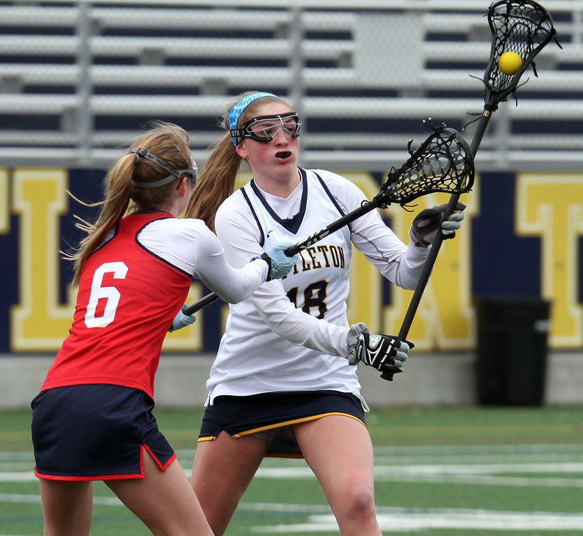 . Littleton vs North Middlesex girls lacrosse. North Middlesex\'s Caitlyn Swartz (6) and Littleton\'s Madison Hunt (18). (SUN/Julia Malakie)