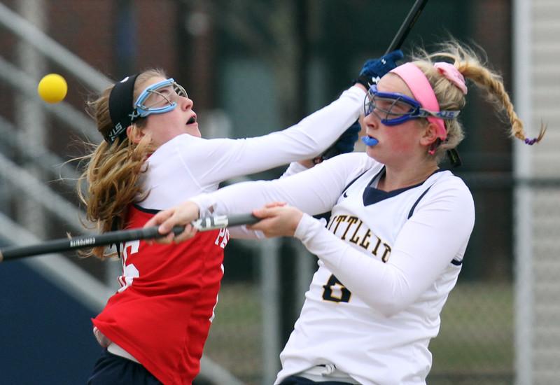 Littleton vs North Middlesex girls lacrosse. North Middlesex's Lindsay Swartz (16) and Littleton's Valerie Crory (6). (SUN/Julia Malakie)