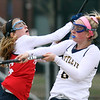 Littleton vs North Middlesex girls lacrosse. North Middlesex's Lindsay Swartz (16) and Littleton's Valerie Crory (6). (SUN/Julia Malakie)