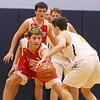 Littleton vs Tyngsboro boys basketball. Tyngsboro's Jason Kelly (20) and Littleton's Kirron Arone (5). (SUN/Julia Malakie)