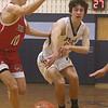 Littleton vs Tyngsboro boys basketball. Tyngsboro's Ryan Gauthier (10) and Littleton's Tyler Merrill (13). (SUN/Julia Malakie)
