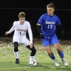 Littleton vs Bromfield boys soccer in MIAA Central Mass Division 4 championship. Littleton's Brandon Witherell (1) and Bromfield's Will Armstrong (17). (SUN/Julia Malakie)