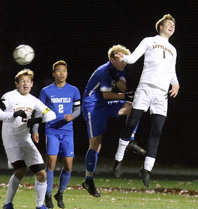 Littleton vs Bromfield boys soccer in MIAA Central Mass Division 4 championship. From left, Littleton's Zachary Susser (2), Bromfield's Tom Khuu (2) and Pasha Sahin (10), and Littleton's Brandon Witherell (1).  (SUN/Julia Malakie)