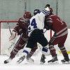 Lowell vs Bedford boys hockey. Lowell's Nicholas Mandeville (6), left, and Brendan DeMarco (16), and Bedford's James Demeo (24). (SUN/Julia Malakie)