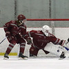 Lowell vs Bedford boys hockey. Bedford's James Demeo (24), and Lowell's Nicholas Mandeville (6) and goalie Jake Viera (1). (SUN/Julia Malakie)