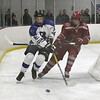 Lowell vs Bedford boys hockey. Bedford's Ittai Weisman (21) and Lowell's Shawn Spring (19). (SUN/Julia Malakie)