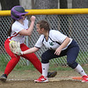 Innovation Academy Charter School vs Lowell Catholic softball. IACS baserunner AManda Stanley (3) gets back safely to first in the bottom of the second inning, Lowell Catholic first baseman Megan Murphy (14) fielding. SUN/Julia Malakie)