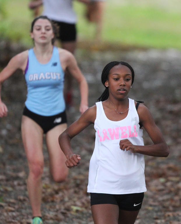 . Lowell, Dracut & Andover cross country. Eventual winner Asaliah Mirambeaux of Lowell, and 2nd place finisher Nikki Andersson of Dracut. (SUN/Julia Malakie)