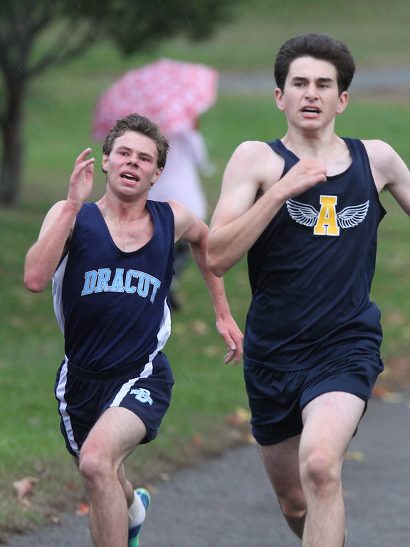 . Lowell, Dracut & Andover cross country. Lucas St. Louis of Dracut (who finished 21st) and Max Tweedale of Andover (20th) sprint to the finish line. (SUN/Julia Malakie)