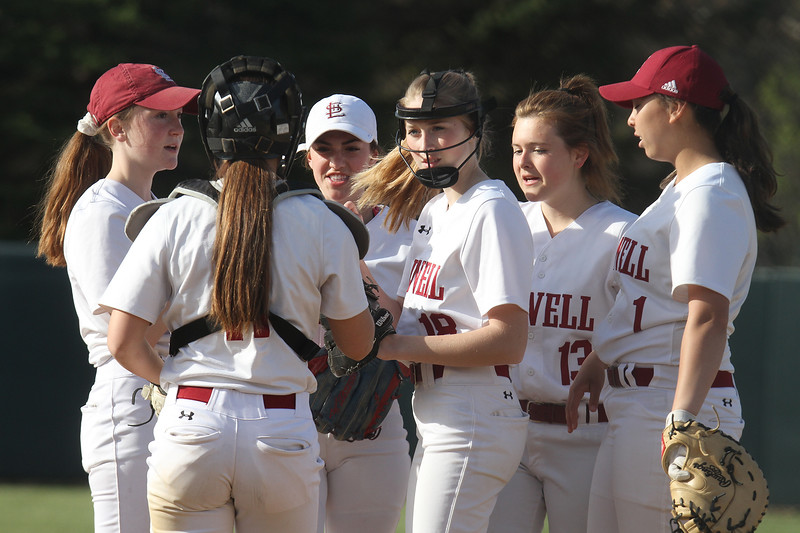 Lowell vs Dracut softball. Lowell pitcher Giana LaCedra (18) win infield including catcher Niky Yrrizarry, second baseman Erin Moore (13) and first baseman Mia Ly (1), before start of sixth inning. (SUN/Julia Malakie)